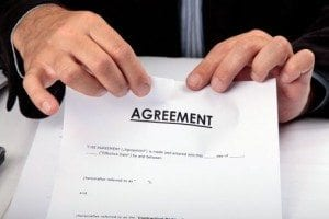 Man tearing up agreement