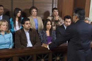 Man in suit talking to jury