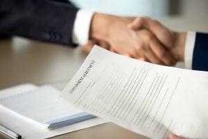 handshake with employment agreement