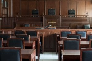 table and chairs in courtroom